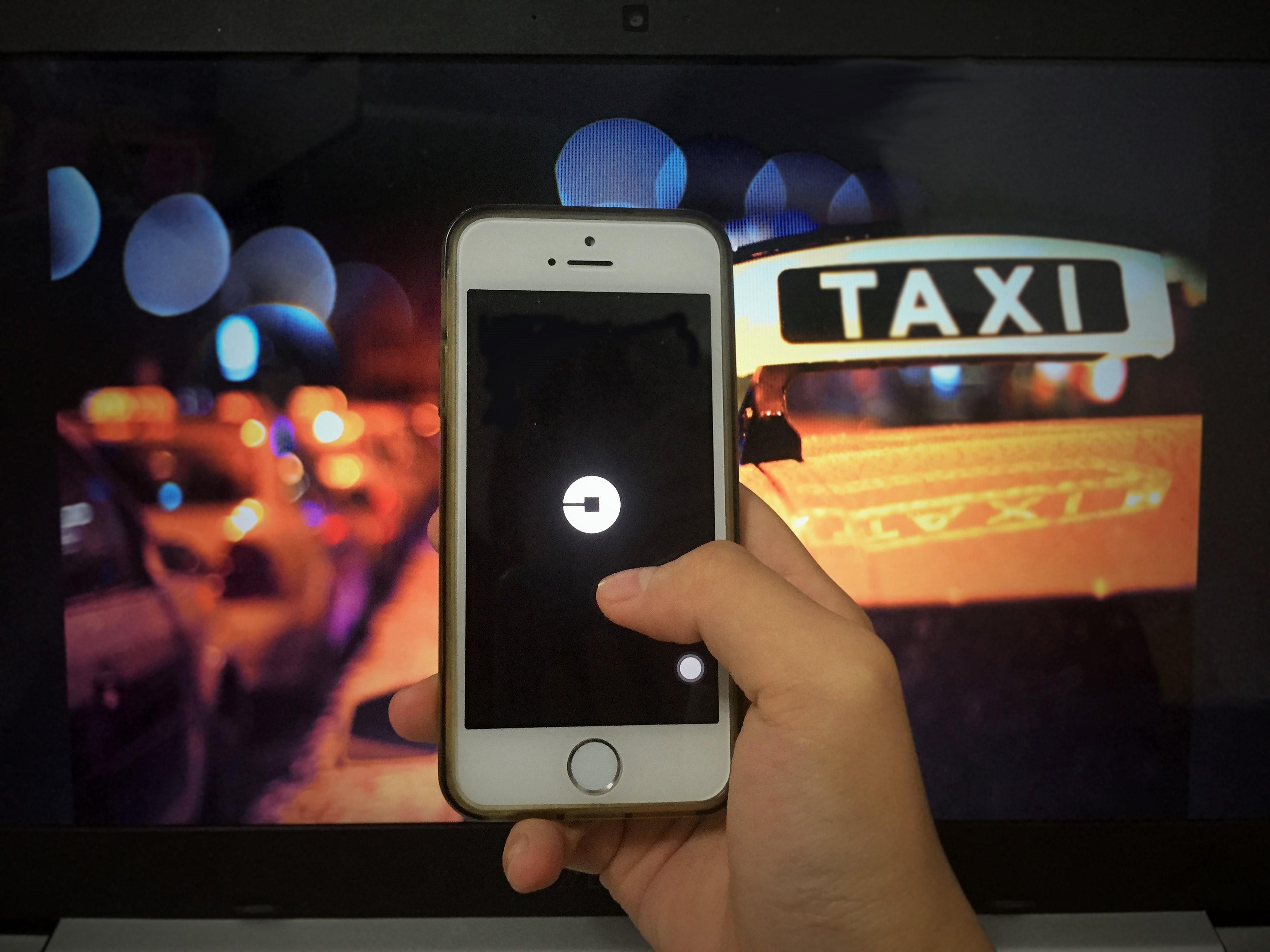 以不完全契約論Uber與計程車之間關係(攝影/布子如)